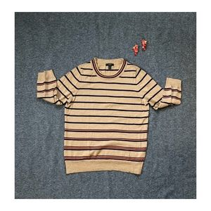A tan wool 3 quarter length sleeve sweater